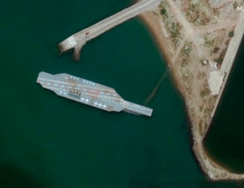 In this Sunday, June 7, 2020 satellite photo provided by Maxar Technologies, a fake aircraft carrier is seen off the coast of Bandar Abbas, Iran. (Satellite image ©2020 Maxar Technologies via AP)