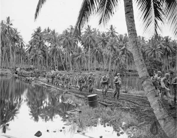 Army units moving toward the front on Guadalcanal, 30 January 1943. (National Archives)