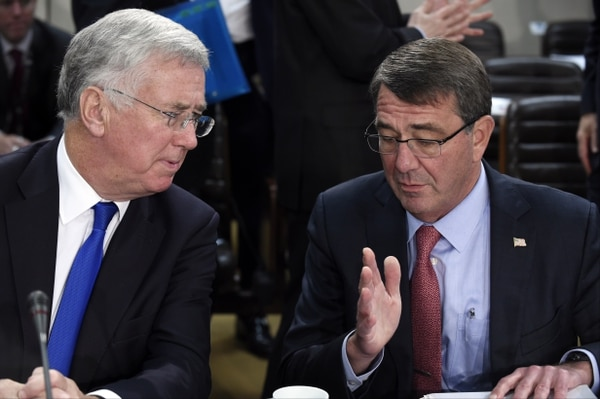 Britain Defense Minister Michael Fallon (L) talks with US Defense Minister Ashton Carter (R) during a Defense ministers meeting at the NATO headquarters in Brussels on October 8, 2015. AFP PHOTO/JOHN THYS (Photo credit should read JOHN THYS/AFP/Getty Images)