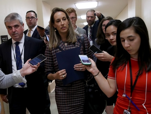 Rep. Mikie Sherrill, D-N.J., center, is among a group opposing calls to fund any less than the requested $753 billion national defense budget for fiscal 2022. (Win McNamee/Getty Images)