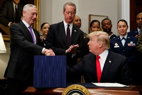 President Donald Trump shakes hands with Secretary of Defense Jim Mattis after signing the National Defense Authorization Act for Fiscal Year 2018, in the Roosevelt Room of the White House Dec. 12. (Evan Vucci/AP)