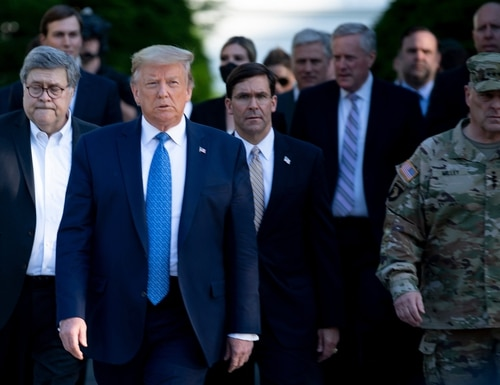 President Donald Trump walks with Attorney General William Barr, left, Secretary of Defense Mark Esper ,center, Chairman of the Joint Chiefs of Staff Gen. Mark A. Milley, right, and others from the White House to visit St. John's Church after the area was cleared of people protesting the death of George Floyd June 1, 2020, in Washington. (Brendan Smialowski/AFP via Getty Images)