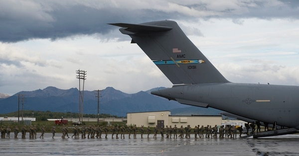 Soldiers of the 4th Infantry Brigade Combat Team (Airborne), 25th Infantry Division, board a C-17 at Joint Base Elmendorf-Richardson, Alaska, Sept. 6 to complete proficiency jumps before deploying to Afghanistan. (Senior Airman Javier Alvarez/Air Force)