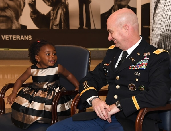 Chiara Jason, 2, smiles at her dad, Mike Jason, who retired May 23 as an Army colonel in a Pentagon ceremony.