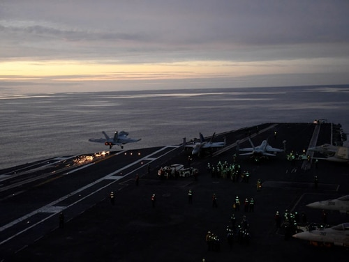 Members of the aircraft carrier Carl Vinson run flight and recovery training on Nov. 3, 2017. A chief suffered horrific injuries that day when a jet ran over his legs. (Navy)