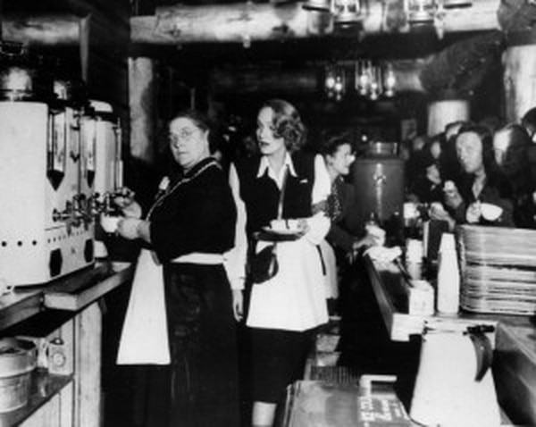 Alleta Sullivan, left, mother of the five Sullivan brothers who lost their lives in the sinking of the light cruiser Juneau, works alongside actress Marlene Dietrich as they serve servicemen in the USO Hollywood Canteen, Calif., Feb. 9, 1944. (U.S. Naval History and Heritage Command)