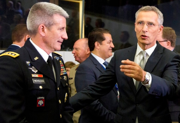 NATO Secretary General Jens Stoltenberg, right, speaks with the top commander of U.S. forces in Afghanistan General John Nicholson during a round table meeting of the North Atlantic Council with Resolute Support Operational Partner Nations at NATO headquarters in Brussels, Friday, June 8, 2018. (Virginia Mayo/AP)