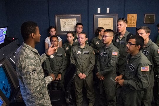 Senior Airman Kristapher Guillen, 436th Operations Support Squadron radar approach control air traffic controller, answers questions from Air Force Junior Reserve Officers' Training Corps cadets during a tour of the RAPCON facility and control tower in July 2019 at Dover Air Force Base, Del. (Roland Balik/Air Force)