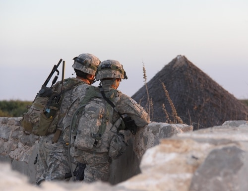Soldiers carry a Manpack Radio at a 2017 Network Integration Evaluation exercise. (U.S. Army)