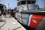 Coasties rescue man, boy, dog after boat capsizes