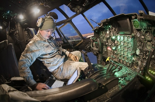 Staff Sgt. Jack Kindell, a crew chief, reviews an electronic technical order prior to moving an MC-130P Combat Shadown across the flightline. The Air Force is working to grow its cyber airmen to better protect its networks from cyber attack. (Airman 1st Class Andrea Salazar/Air Force)