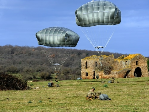 U.S. paratroopers from the 173rd Airborne Brigade and Italian paratroopers conduct a static-line jump near Monte Romano, Italy, Jan. 29, 2020. (Elena Baladelli/Army)