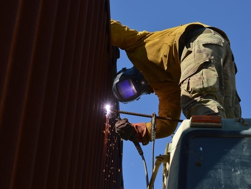 An engineer welds rebar on the border wall in Sasabe, Ariz., Feb. 7, 2019. (Sgt. 1st Class TaWanna Starks/Army)