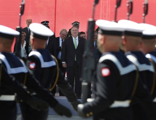 U.S. Secretary of State Mike Pompeo stands in respect for the Polish military as Poland marks the centennial of the Battle of Warsaw, a Polish military victory in 2020 that stopped the Russian Bolshevik march toward the west, in Warsaw, Poland, Saturday Aug. 15, 2020. (Czarek Sokolowski/AP)