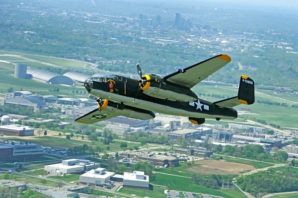 The Champaign Gal B-25 Mitchell bomber performs a flyby over the National Museum of the U.S. Air Force at Wright-Patterson Air Force Base in honor of the 70th reunion of the Doolittle Tokyo Raiders in 2013. (Tech. Sgt. Bennie J. Davis III/Air Force)
