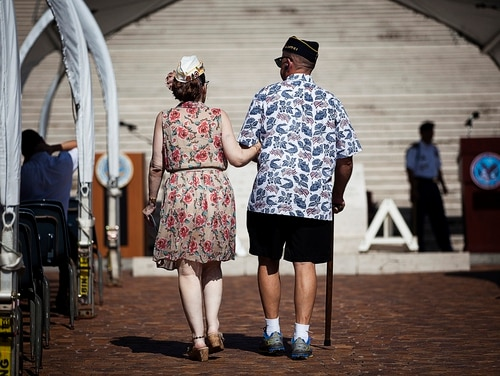 Army veteran Camron Fox (right) walks to his seat with help from his wife, Penny, during a National POW/MIA Recognition Day ceremony in Honolulu on Sept. 21, 2012. (Cpl. Reece Lodde/Marine Corps)