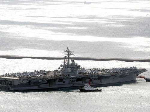 The aircraft carrier USS Ronald Reagan (CVN 76) is escorted into Busan port, South Korea, after completing a joint drill with the South Korean military, Saturday, Oct. 21, 2017. U.S. naval commanders on Saturday reiterated Washington's