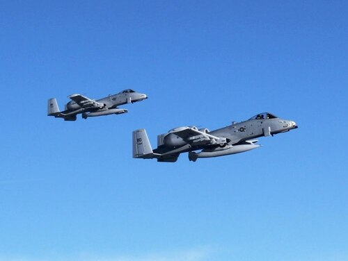 A-10 Thunderbolt II aircraft flown by pilots from the 107th Fighter Squadron head toward Afghanistan after departing Selfridge Air National Guard Base, Mich., Sept. 26, 2011. The aircraft, pilots and about 300 support personnel are schedule to operate in Afghanistan through early 2012.