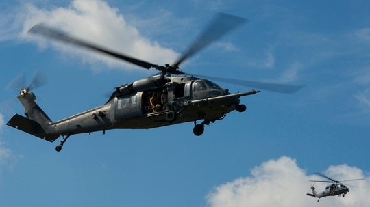 Two U.S. Air Force HH-60 Pave Hawk helicopters from the 301st Rescue Squadron, Patrick Air Force Base, Florida, performs maneuvers during a training scenario supporting pararescuemen at Guardian Centers, Perry, Georgia, October 11, 2017. Members from the U.S. Air Force's 308th, 301st and 38th Rescue Squadrons and U.S. Army's 20th Special Forces Group, will train for five days at the Guardian Centers, which is a metroplex providing 80 structures, 16 blocks and 75 acres of realistic urban training to hone search and rescue skills before their deployment. (U.S. Air Force photo by Master Sgt. Stephen D. Schester)