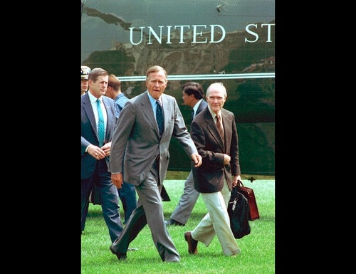 In this August 19, 1991, file photo, President George Bush, accompanied by national security adviser Brent Scowcroft, right, arrives back at the White House after he interrupted his vacation following the overthrow of Soviet President Gorbachev. (Barry Thumma/AP)