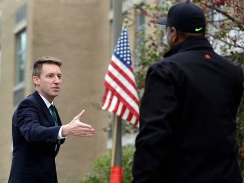 Jason Kander, left, shown in November 2016 while running for U.S. Senate, dropped his bid to become the next mayor of Kansas City on Oct. 2 after acknowledging a private battle with depression and post-traumatic stress disorder related to his military service. (Jeff Roberson/AP)