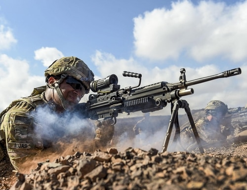 Pvt. Michael Rojas fires an M249 light machine gun during small arms training in Arta, Djibouti, May 2, 2017. (Staff Sgt. Nicholas M. Byers/Air Force)