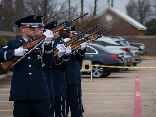 The Dyess Air Force Base Honor Guard perform a three-volley salute during the military funeral honors of Staff Sgt. Cole Condiff, a special tactics combat controller, at the Church of Jesus Christ of Latter-day Saints in Richardson, Texas, Dec. 21. (Senior Airman Rachel Williams/Air Force)