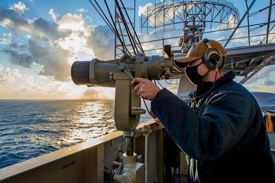 Seaman Cedric Volle stands aft lookout watch aboard the Nimitz-class aircraft carrier USS Dwight D. Eisenhower (CVN 69) in the Mediterranean Sea, April 1, 2021. (Mass Communication Specialist Seaman Jacob Hilgendorf/Navy)