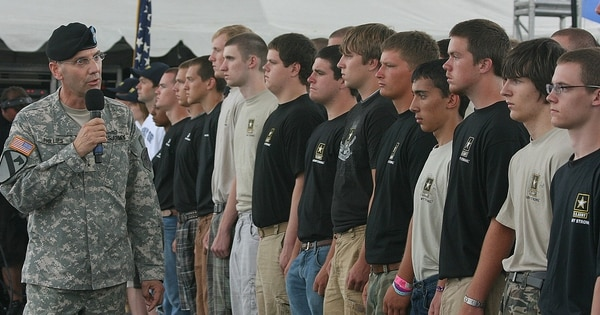 Then-Brig. Gen. Jeffrey E. Phillips takes part in an enlistment ceremony in Oshkosh, Wis., in 2009. Phillips, now a member of Mission: Readiness, says youth fitness issues are critical to the strength of the future force. (Army)