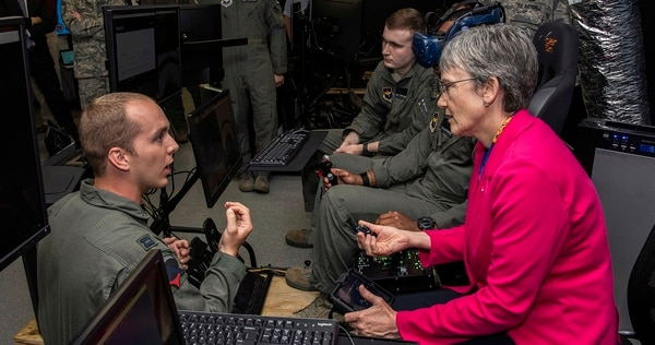 Capt. John Joern, Pilot Training Next instructor, briefs Air Force Secretary Heather Wilson as they observe student pilots train with virtual reality systems at the Armed Forces Reserve Center at Austin-Bergstrom International Airport in Austin, Texas, June 27. (Johnny Saldivar/Air Force)