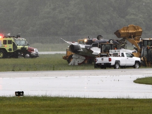 A Thunderbirds F-16 skidded off the runway in June after landing too fast in the rain and overturning. (WHIO via AP)