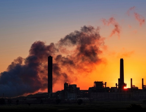 In this July 27, 2018, photo, the Dave Johnson coal-fired power plant is silhouetted against the morning sun in Glenrock, Wyo. The Trump administration announced on Wednesday, June 19, 2019, that it has rolled back a landmark Obama-era effort targeting coal-fired power plants and their climate-damaging pollution. (J. David Ake/AP)