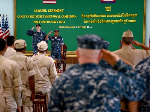 Capt. Fred Kacher, commander of Destroyer Squadron (DESRON) 7, and Rear Adm. Ros Veasna, deputy commander of Ream Naval Base, salute during the closing ceremony of Cooperation Afloat Readiness and Training (CARAT) Cambodia 2014. (MC1 Jay C. Pugh/Navy)