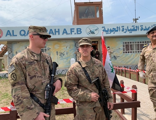U.S. soldiers stand guard during the hand over ceremony of Qayyarah Airfield, Iraqi Security Forces, in the south of Mosul, Iraq. (Ali Abdul Hassan/AP)