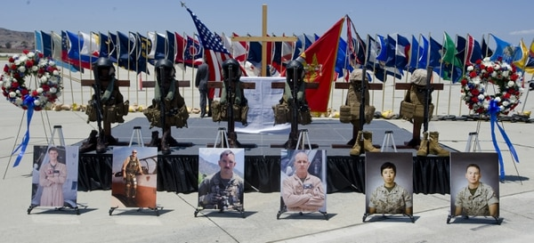 Photos of six Marines killed in a helicopter crash while on a rescue mission for earthquake victims in Nepal are displayed with flight vests, helmets, rifles and boots during a memorial service at Camp Pendleton, Calif., Wednesday, June 3, 2015. The six were, from left, Capt. Dustin R. Lukasiewicz, Capt. Christopher L. Norgren, Sgt. Ward M. Johnson IV, Sgt. Eric M. Seaman, Cpl. Sara A. Medina, and Lance Cpl. Jacob A. Hug. (Sam Gangwer/The Orange County Register via AP) MAGS OUT; LOS ANGELES TIMES OUT; MANDATORY CREDIT ///ADDITIONAL INFORMATION: marines.0604 8 p.m. – 6/3/15 – SAM GANGWER, ORANGE COUNTY REGISTER -
