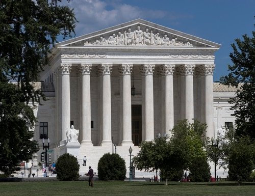 In this June 26, 2017 photo, The Supreme Court is seen in Washington. A Supreme Court with a reconstituted conservative majority is taking on a new case with the potential to financially cripple Democratic-leaning labor unions that represent government workers. The justices deadlocked 4-4 in a similar case last year. (AP Photo/J. Scott Applewhite)