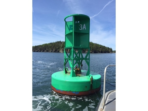 The space in which a sound-signaling brass bell typically hangs on this offshore buoy is empty after the bell was stolen, off the coast of Maine. Stealing a sound signaling device off a buoy is a federal offense and can be punishable with heavy fines or even imprisonment. (U.S. Coast Guard)