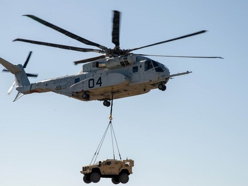 A CH-53K King Stallion lifts a Joint Light Tactical Vehicle during a demonstration, Jan. 18. (Navy)
