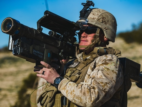 Cpl. Kyle Peterson, low altitude air defense gunner, 3rd LAAD, 3rd Marine Division, aims a Stinger missile. Systems fielding in 2020 could allow him to fire the same missile from a protected vehicle with advanced radar. (Lance Cpl. Colton Brownlee/Marine Corps)