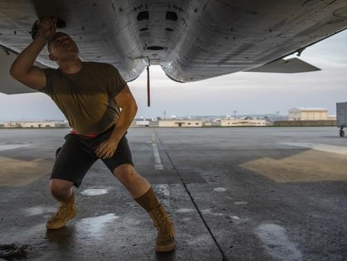 Air Force Airman 1st Class Richard Flagg, 67th Aircraft Maintenance Unit crew chief, performs pre-flight checks on an F-15C Eagle Jan. 23, 2020, at Kadena Air Base, Japan. This was the first time maintenance airmen were authorized to work in shorts on Kadena Air Base. (Senior Airman Rhett Isbell/Air Force)