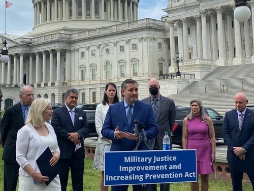 Sen. Ted Cruz, R-Texas (center), speaks during a press conference outside the Capitol in support of a measure to remove sexual misconduct cases from the military chain of command on April 29. Sens. Chuck Grassley, R-Iowa (back left), Kirsten Gillibrand, D-N.Y. (front left), Joni Ernst, R-Iowa (second from right) and Mark Kelly, D-Ariz. (right) also backed the measure. (Photo courtesy of Cruz)