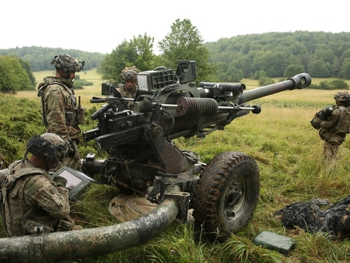U.S. soldiers assigned to the 173rd Infantry Brigade Combat Team (Airborne) emplace an M119A3 Howitzer during Saber Junction 20 at Hohenfels Training Area, Germany on Aug. 15, 2020. (Sgt. Randis Monroe/Army)