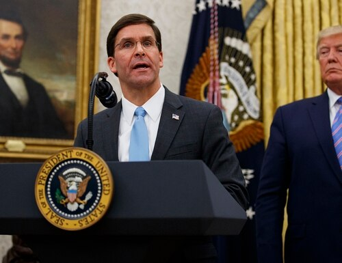 President Donald Trump looks to Secretary of Defense Mark Esper during a ceremony in the Oval Office at the White House in Washington, Tuesday, July 23, 2019. (Carolyn Kaster/AP)