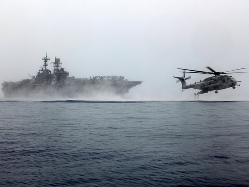 Reconnaissance Marines with the 24th Marine Expeditionary Unit's Maritime Raid Force, sourced from Force Reconnaissance Company, 2nd Reconnaissance Battalion, and embarked on the amphibious assault ship Iwo Jima (LHD 7), jump from a CH-53E Super Stallion during helocast training in the Gulf of Aden, May 28, 2015. (Cpl. Joey Mendez/Marine Corps)