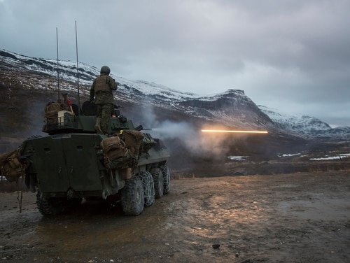 U.S. Marines with Marine Rotational Force-Europe 19.1 (MRF-E) fire rounds from a Light Armored Vehicle during Exercise Northern Screen at Setermoen, Norway, Nov. 5, 2018. The exercise increases the Marines' proficiency in cold-weather, arctic, and mountainous environments. (U.S. Marine Corps photo by Cpl. Ashley McLaughlin)