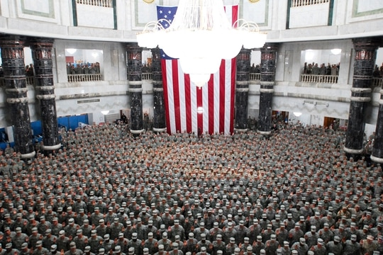 1,215 U.S. service members from all over Iraq re-enlisted during a ceremony in the Al Faw Palace rotunda at Camp Victory in Baghdad, July 4, 2008. Multinational Force-Iraq Commander Army Gen. David Petraeus led the ceremony. (MNF-I Public Affairs)