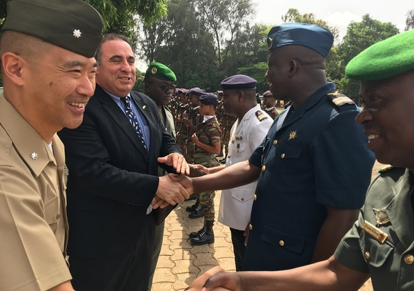 U.S. Marine Lt. Col. Joseph Lee, U.S. defense attaché to Ghana and Benin, and Ambassador Alexander Laskaris, deputy to the commander U.S. Africa Command civil-military engagement, are greeted by the Benin Armed Forces' top leadership during an engagement, March 19-20, in Cotonou, Benin. Laskaris led a 3-country engagement mission to Benin, Nigeria, and Cote d'Ivoire. (Col. Chris Karns/U.S. Africa Command)