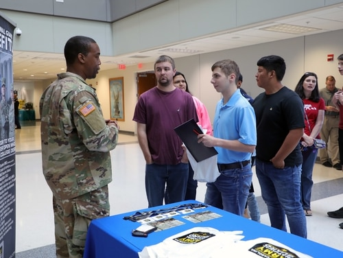 An Army National Guard recruiter talks with rising high school students. (Staff Sgt. Leticia Samuels/Army)