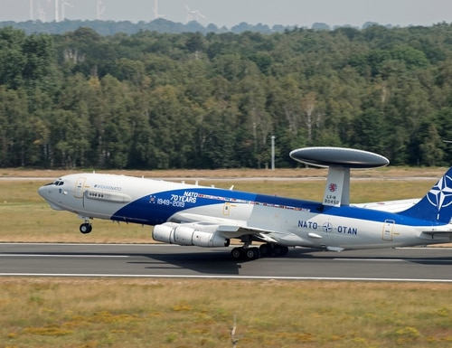 NATO AWACS aircraft is on its way to an airshow in Estonia with a special decal on its fuselage celebrating the Alliance 70th anniversary, seen in July 2019. (NATO)