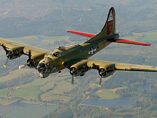 The Nine-O-Nine, the Collings Foundation B-17 Flying Fortress that crashed in Connecticut Oct. 2, flies over Thomasville, Ala., in April 2002 during a flight from Decatur to Mobile. (John David Mercer/Press-Register via AP)